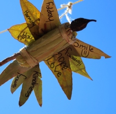 A completed peace dove hanging in formation in the school yard