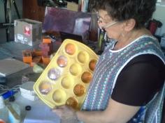Margie preparing the glitter for the muffin candles