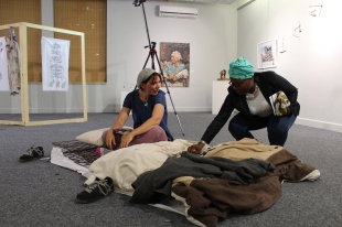 "2015, ""Archived Memories', National Art Gallery of Namibia, Windhoek, Namibia. This is a live, interactive performance art piece. There are 169 personal memories about beds and mattresses that I recorded as a catalogue. I made corresponding tags from clay and recorded the 169 numbers from the catalogue on them. The audience was allowed to chose a memory tag and I would read the corresponding memory in the catalogue to them. Memories included: childhood memories until current."